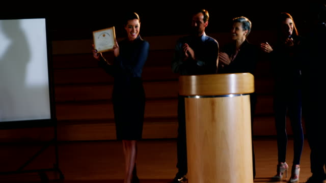 Female business executive receiving award video