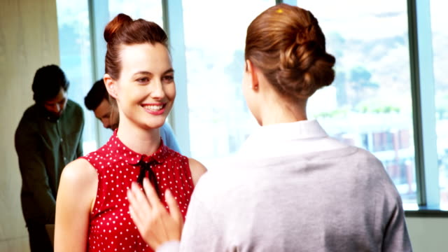 Female business executives giving high five in conference room video
