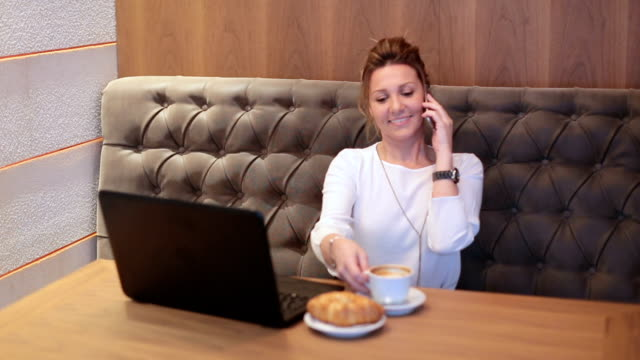 Female business woman relaxed drinking coffee after work video