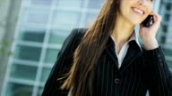 Female Caucasian Financial Advisor Smart Phone City Outdoors video