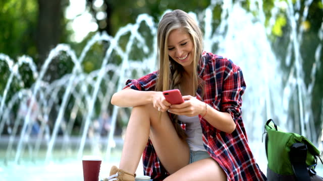 Female chatting on the phone, smiling and having fun video