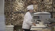 Female chef kneading pizza dough video