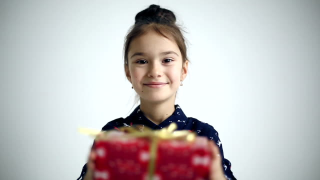 Female child gives gift surprised and glad. video