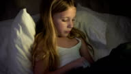 Female Child Going to Bed Using Technology video