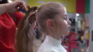Female child in children beauty salon video