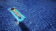 Female Child on Air Bed in Swimming Pool video