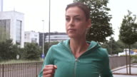 SLO MO Female city runner in motion video