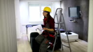 Female construction worker with tools video