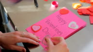 A Female Creating A Happy Valentines Day Card With That Says Love You video