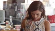 Female Customer Browsing In Delicatessen Shot On R3D video
