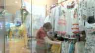 A female customer is in search for clothing video