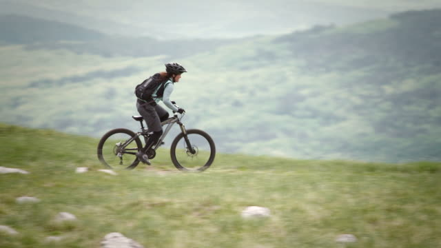HD: Female Cycler Speeding Downhill video
