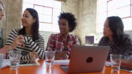 Female Designers Having Meeting In Modern Office Shot On R3D video