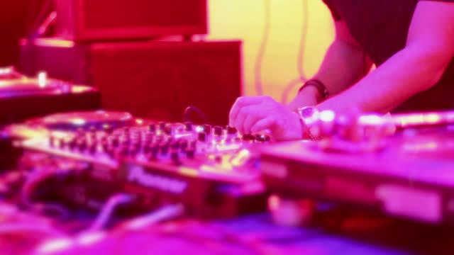 Female DJ hands tweaking controls on professional turntable video