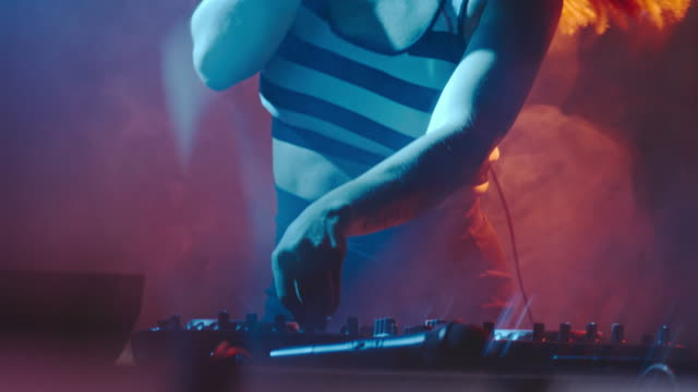 Female DJ Mixing and Cueing Songs at Party video