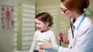 Female Doctor Examining Child With Stethoscope video