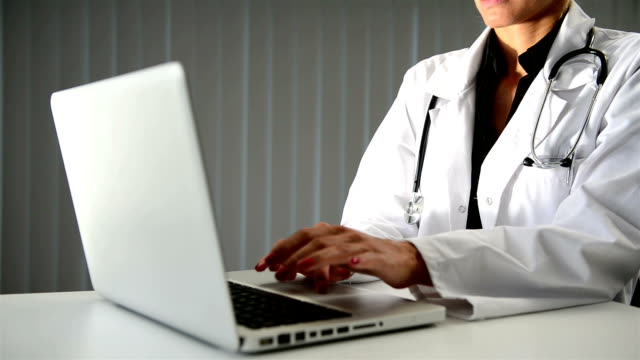 Female doctor hand typing on laptop video
