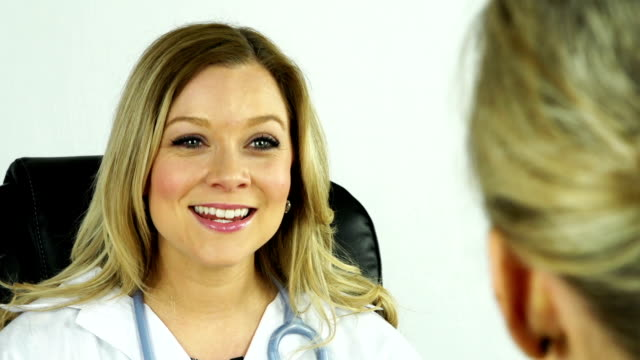 Female doctor in the office with patient video