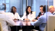Female Doctor Leads a Meeting with Professionals - WS video