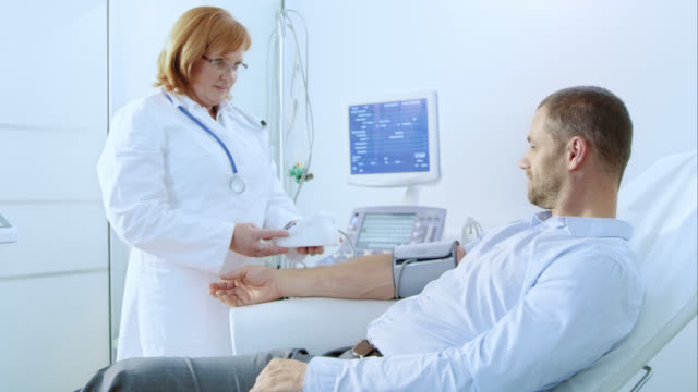 Female doctor measuring a patient's blood pressure video
