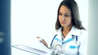 Female doctor taking a folder in medical clinic video