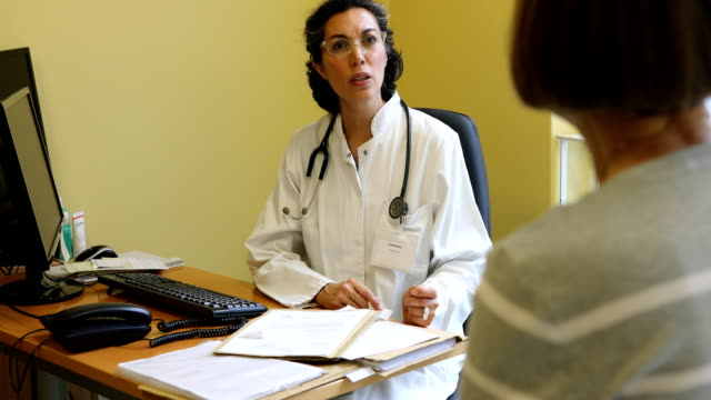 Female doctor talking to patient at clinic video
