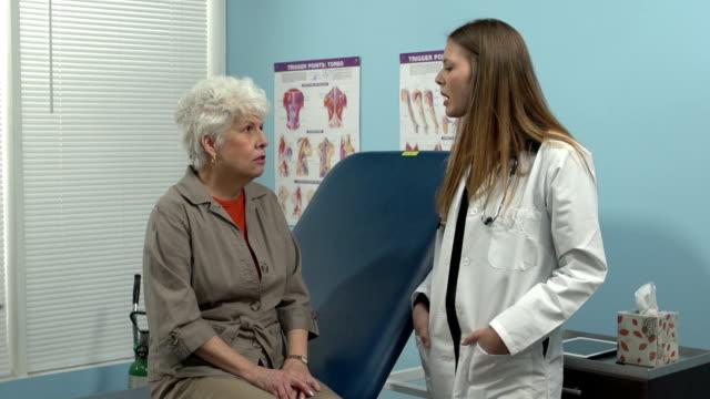 Female doctor talks to senior patient video