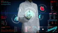 Female doctor touching digital screen, Scanning brain, heart, lungs, internal organs in digital display dashboard. X-ray view. video