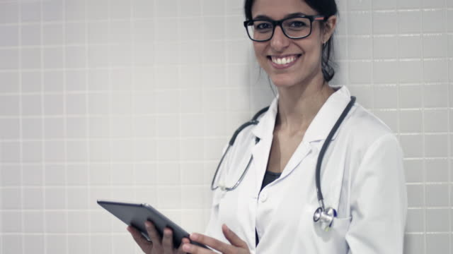 Female doctor using a digital tablet video