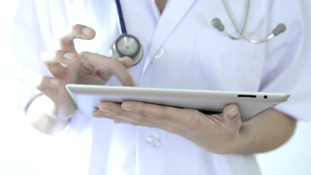 Female Doctor using digital tablet with stethoscope video