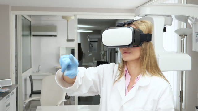 Female doctor using virtual reality headset video