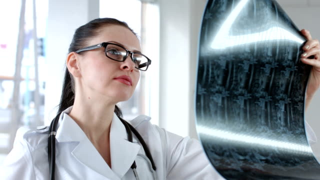 Female doctor viewing mri scan and calling video