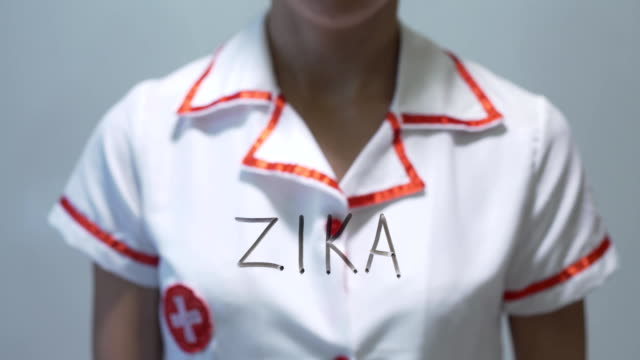 ZIKA, Female doctor writing on transparent screen video