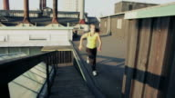 Female doing parkour flow on rooftop video
