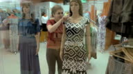 A female dreams of the dress that is on mannequin video