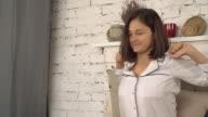 Female dressed in sleepwear indoors video