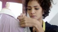 Female dressmaker working in fashion design studio video