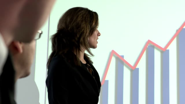 Female employer happily presenting company's profits video