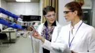 Female engineers working in research lab video