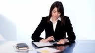 Female executive at desk. video