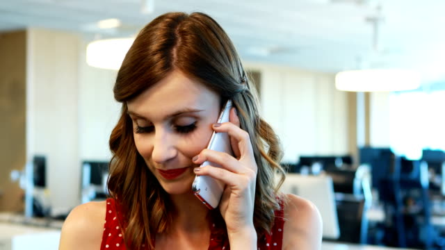 Female executive talking on mobile phone video