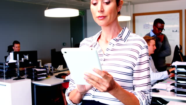 Female executive using digital tablet video