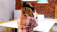 Female executive using virtual reality headset video