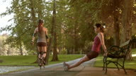 DS Female exercising on a park bench video