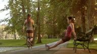 DS Female exercising on park bench video