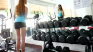 Female exercising with Dumbbells video