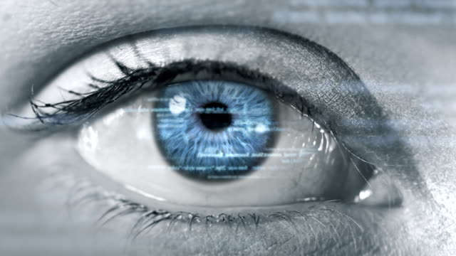 Female eye with program code. Futuristic. Technology. Blue-Green. video