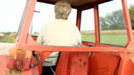 HD: Female Farmer Driving Tractor video