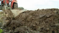 HD: Female Farmer Plowing The Soil video