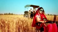 Female farmer working on laptop in the field video